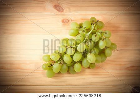Gree Grapes On Wooden Background. Selective Focus.