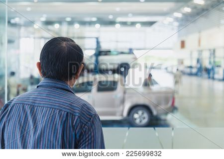 Adult Man Watching And Keep Car Maintenance Checkup In High Standard Garage For Safety