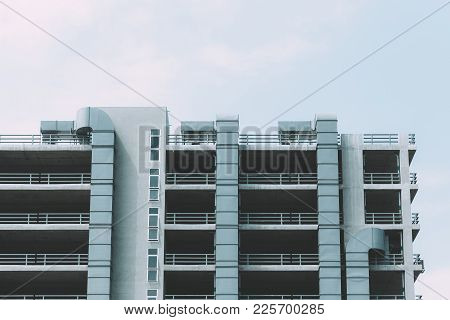 Car Park Building With Air Ventilation Pipe In Modern City Vintage Colortone.
