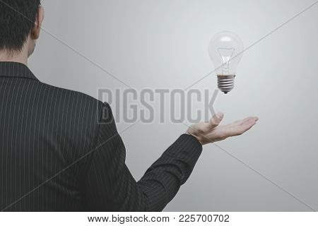 Asian Business Man With Light Bulb Creative And Thinking Marketing Idea Concept