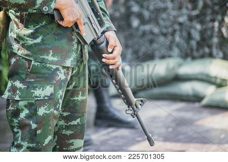 Soldier With Colt M16 Gun Stand Guard To Security Military Camp