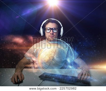 technology, virtual reality, gaming, let's play and people concept - young man in headset playing computer game and streaming playthrough or walkthrough video over space background