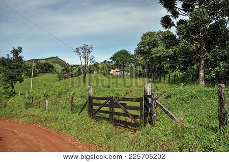 View Of Farm Gateway To The Side Of Rural Road Near The Town Of Joanopolis. In The Countryside Of Sã