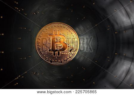 On A Gray Background In Accelerator Is Gold Coin Of A Virtual Digital Crypto Currency - Bitcoin For