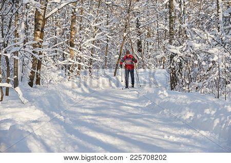 Moscow, Feb. 01, 2018: Skiing Man In City Forest Park Sokolniki At Sunny Winter Day. Winter Ski Spor