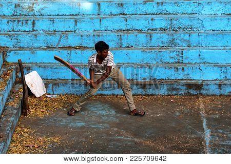 Bentota, Sri Lanka - Circa December 2016: Local Sri Lankan Man Plays Cricket Outdoors. Cricket Is A