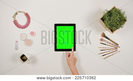 Lady's Finger Scrolling On The Green Touchscreen
