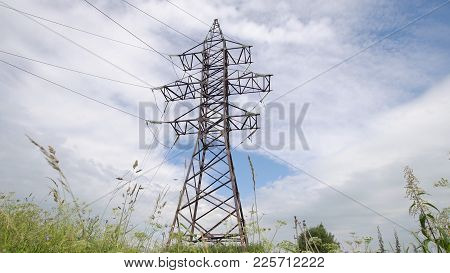 High Voltage Post.high-voltage Tower Sky Background. High-voltage Electrical Insulator Electric Line