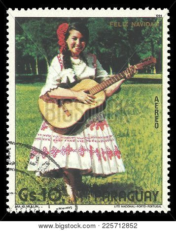 Paraguay - Circa 1984: Stamp Printed By Portugal, Color Edition On Christmas, Shows Paraguayan Woman