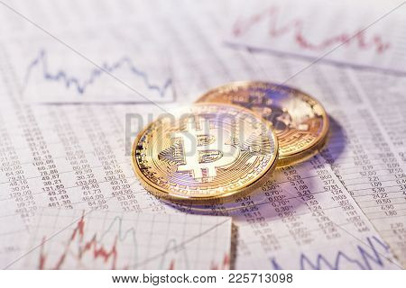 Two Bitcoin Coins With Tables And Graphs With Foreign Exchange Rates