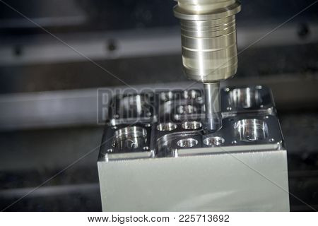 The Cnc Milling Machine Cutting The Sample Part.the Tool Length Measurement On Cnc Machine.