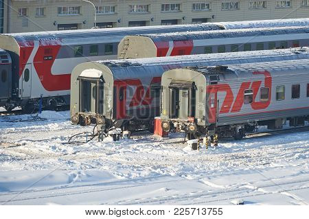 Moscow, Feb. 01, 2018: Winter View On Railway Passenger Coaches Cars At Rail Way Depot Under Snow. P
