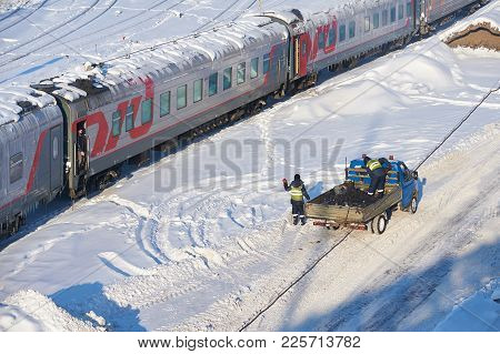 Moscow, Feb. 01, 2018: Winter Day View On Railway Passenger Coaches Cars Under Snow And Ice On Roofs