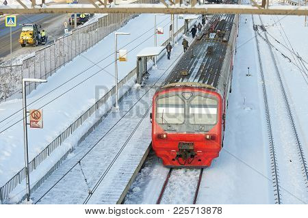 Moscow, Feb. 01, 2018: Winter Day View Russian Railway Red Electric Passenger Train At Rail Way Stat