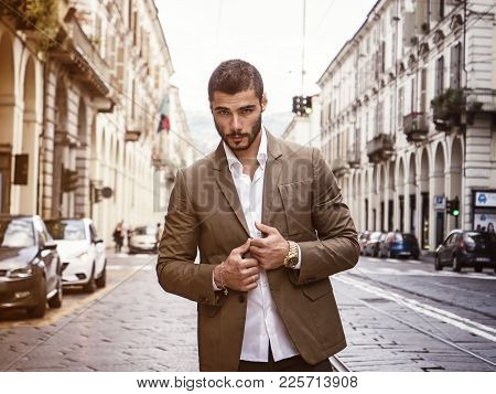 Attractive Man Outdoor Wearing Elegant Jacket, In European City, Turin In Italy