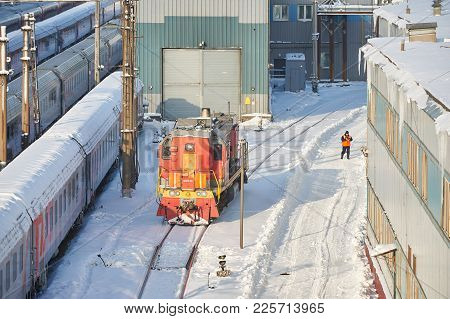 Moscow, Feb. 01, 2018: Winter View On Railway Locomotive In Passenger Trains Depot Under Snow. Russi