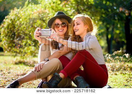 Urban Girlfriends Taking A Selfie In The Park
