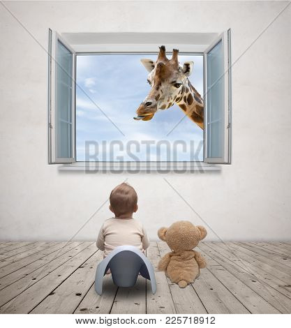 Picture Of Baby On The Potty Watching Giraffe