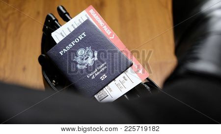 United States Passport And Boarding Pass Are On The Top Of Bag