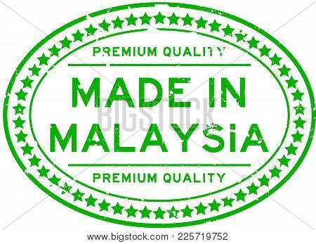 Grunge Green Premiumq Quality Made In Malaysia Oval Rubber Seal Business Stamp On White Background