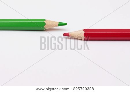 Two Pencils Of Green And Red, Symbolize The Opposite