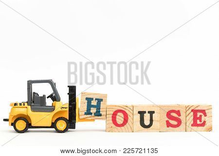 Toy Forklift Hold Letter Block H To Complete Word House On White Background