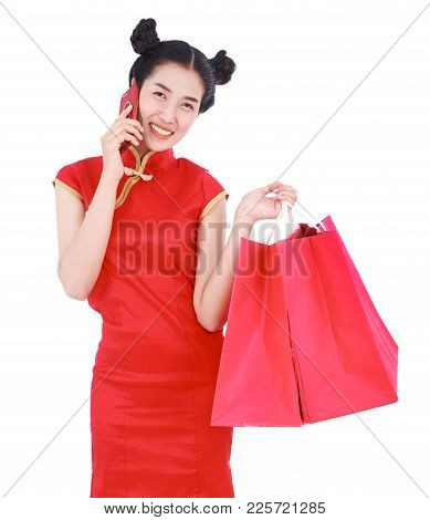 Woman Holding Shopping Bag And Using Mobile Phone In Concept Of Happy Chinese New Year Isolated On W