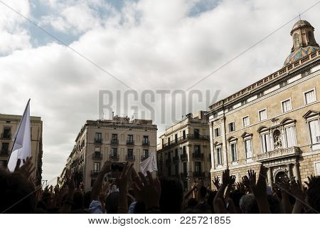 A Lot Of People Protest With Their Hands Up And White Flags In Front Of A Public Building