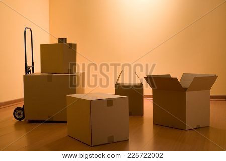 Boxes In An Empty Room Representing Concept Of Home Moving