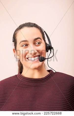 Cheerful Woman Using Headset Working In Call Center In A Concept Of A Call Center Operator, Customer