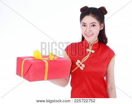 Woman Holding Red Gift Box In Concept Of Happy Chinese New Year Isolated On A White Background