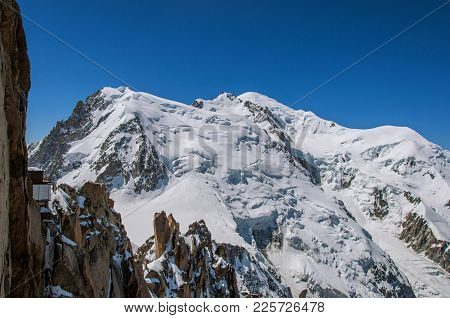 Snowy Mont Blanc In A Sunny Day, Viewed From The Aiguille Du Midi, Near Chamonix. A Famous Ski Resor