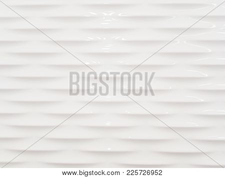 Abstract Background Of White Smooth And Sleek Wall With Embossed Pattern.