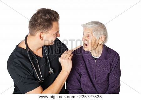 Senior Ill Woman With Friendly Male Physician Doing Daily Checkup On Isolated Background