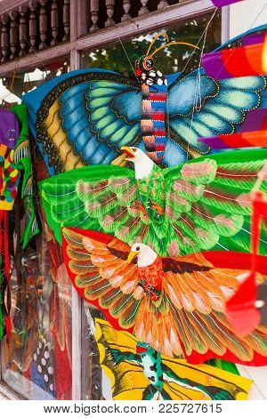 Souvenir Shop With Colorful Kites In Shapes Of Animals, Insects And Mythical Creatures. Bali, Indone