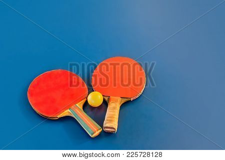 Tabletennis Or Ping Pong Rackets And Yellow Balls On Blue Table. Sport Concept. Table Tennis