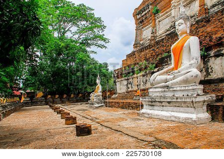 Row Of Buddha Statue Sitting At Wat Yai Chaimongkol Temple In Phra Nakhon Si Ayutthaya Historical Pa