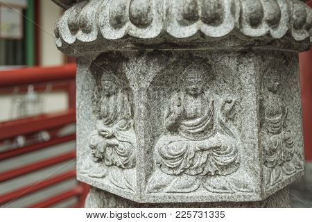 Stone Relief In The Yard Of Buddha Tooth Relic Temple In Singapore