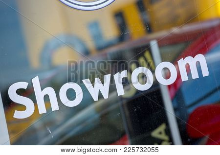 Showroom Written In White Sticker Carved And Embossed On Store Glass