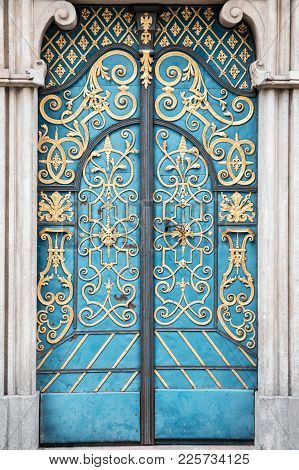 Vintage Old Blue Door With A Gold Ornament