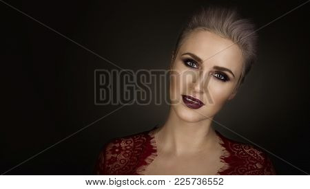 Portrait Of A Beautiful Blond Woman With Short Hair And Bright Make-up