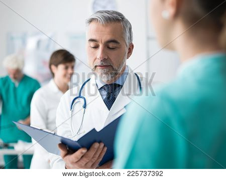 Doctor Examining A Patient's Medical Records
