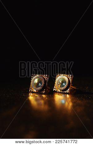 Masculine Accessory - Golden Cufflinks On Black Background
