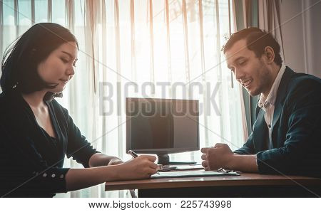 Asian Woman Is Signing On A Contract Deal For Job Or Business Agreement