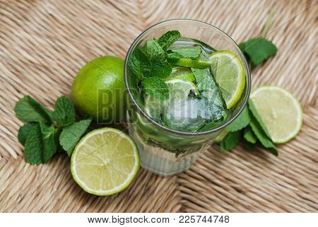 Mojito Summer Cocktail With Ice, Lime And Mint Leaves