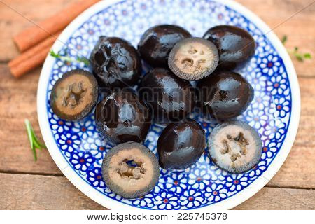 Black Candied Walnuts Or Saint John Nuts. German Delicacy To Cheese, Meat Or Dessert.