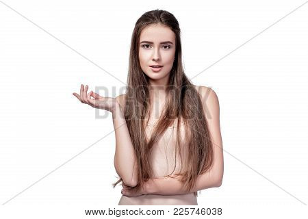Portrait Of Indignant Beautiful Woman With Long Hair Isolated On White Background.