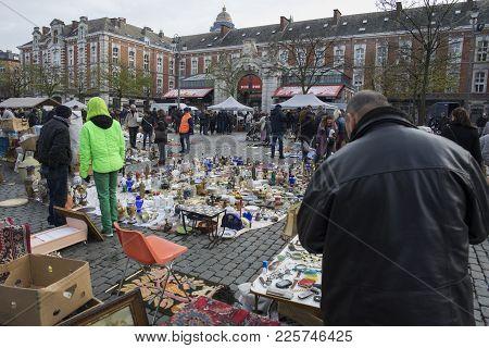 Brussels / Belgium - November 25th 2017: The Marolles Flea Market In Brussels With People Browsing T