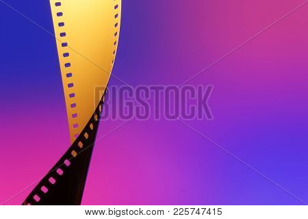 Camera negative film. Selective focus on film perforation. Unprocessed color motion picture film. In