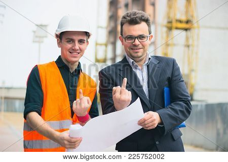 Young Business Man At Construction Business Plans To Make Their Work More Efficient.. Warm Orange Li